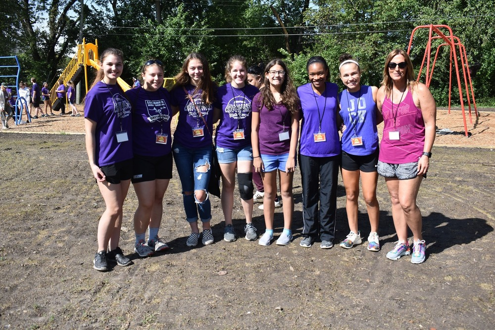 LHS Girl's Basketball team helps out