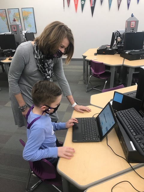Mrs. Wood engages students  during  tech time